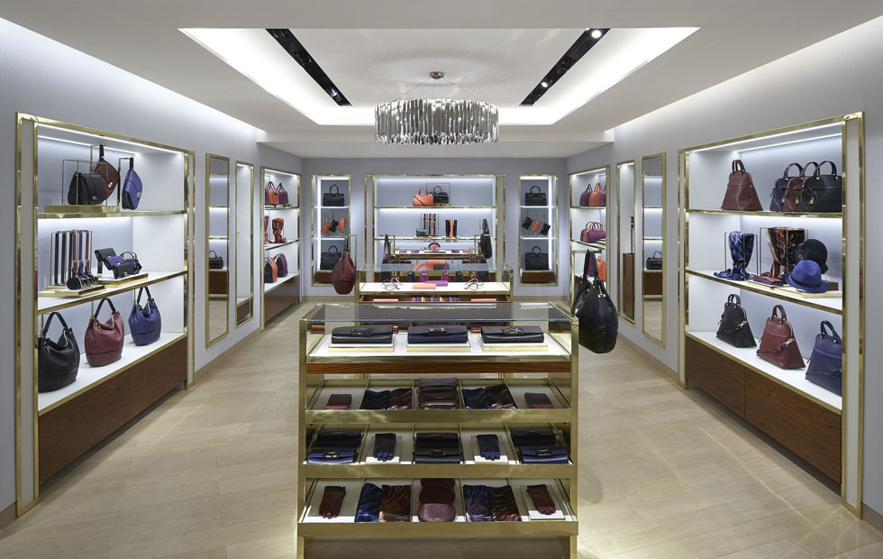 Slider Furla Retail Store, Chandelier coving highlights to compliment the design, London, UK