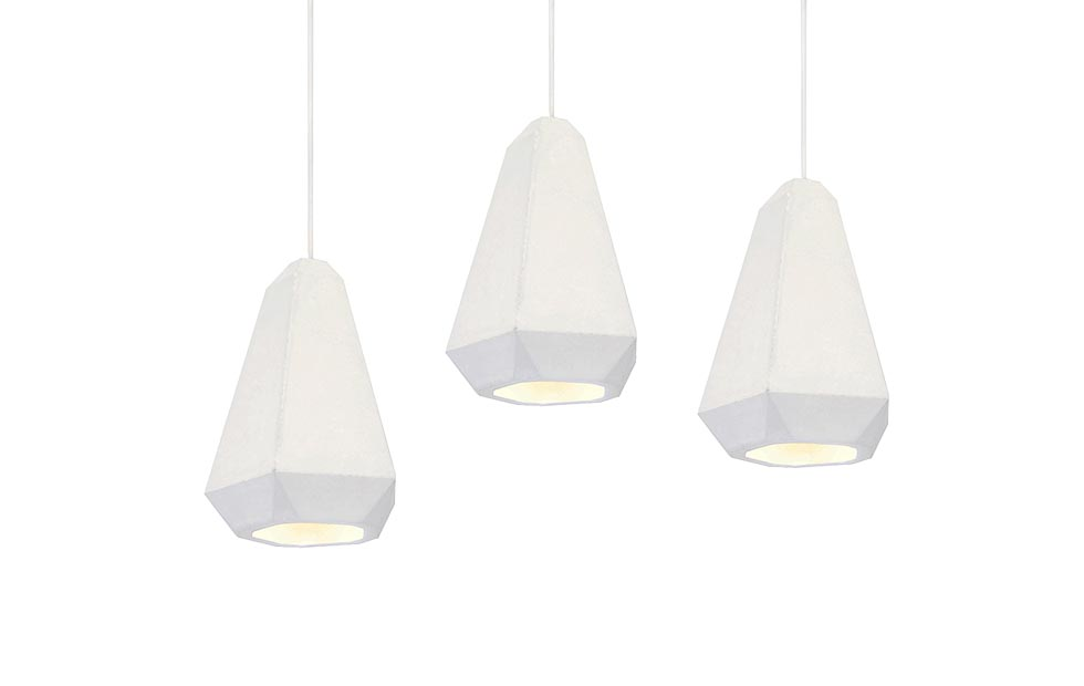 Slider Innermost geometric forms and crisp white lines of the Portland Plaster Pendant