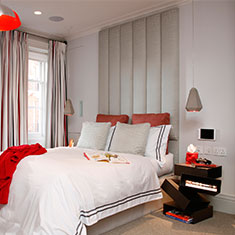 portland concrete and red pendant in bedroom