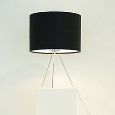 tripod lamp with kobe wool black shade on a table
