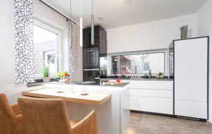 brixton spot pendant lights in graphite and white over a kitchen counter