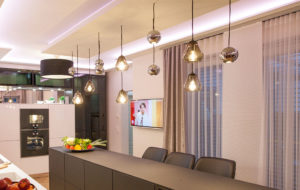 core and boule pendant lights above kitchen island