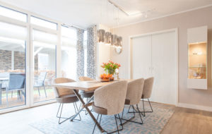 facet pendant light in polished stainless steel in dining area