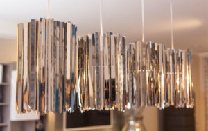 facet pendant light in polished stainless steel