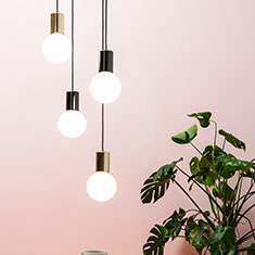 purl drop led pendant light cluster with a plant