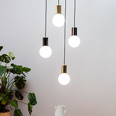 purl drop led pendant light cluster over a coffee table closeup