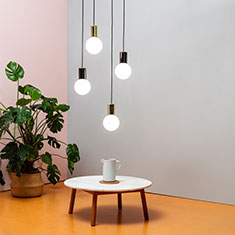 purl drop led pendant light cluster over a coffee table