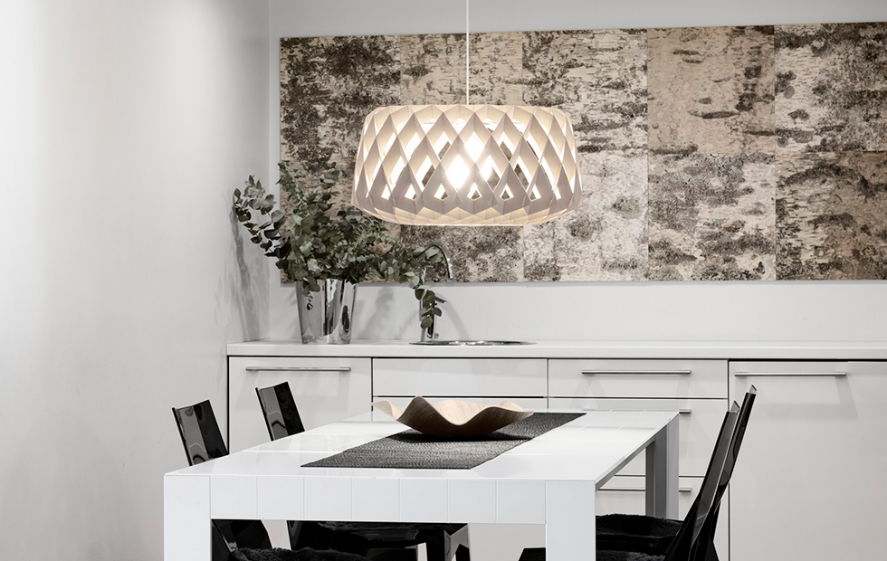 large pilke 60 light turned on in a dining room