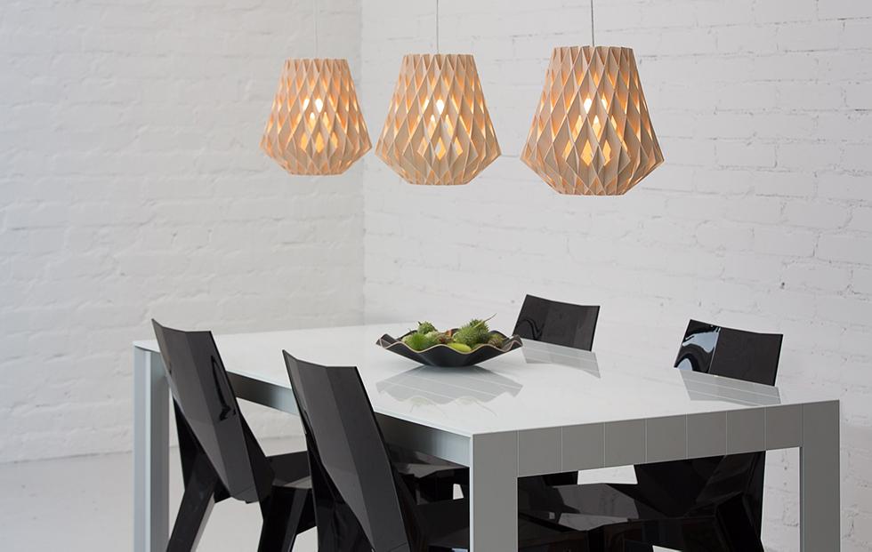 three pilke 28 birch pendants lights in a dining room